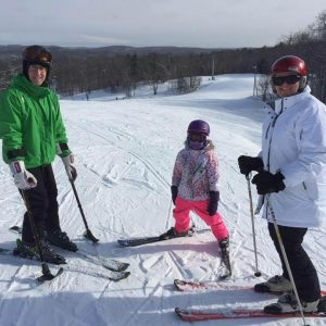 John Chafe skiing with his family