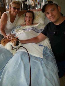 Ashley Ruelland lying in hospital bed