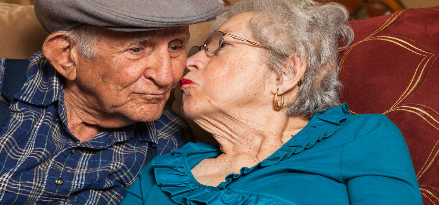 Elderly couple embrace