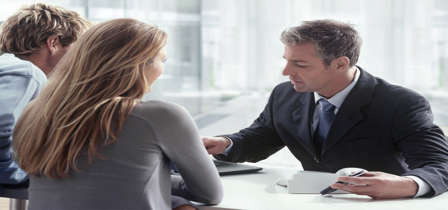 Lawyer, financial advisor or accountant consulting with client