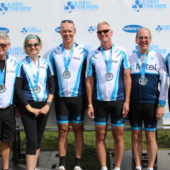 Group of cyclists with medals