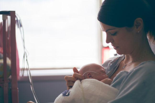 Jamie Eberts holding baby Olivia