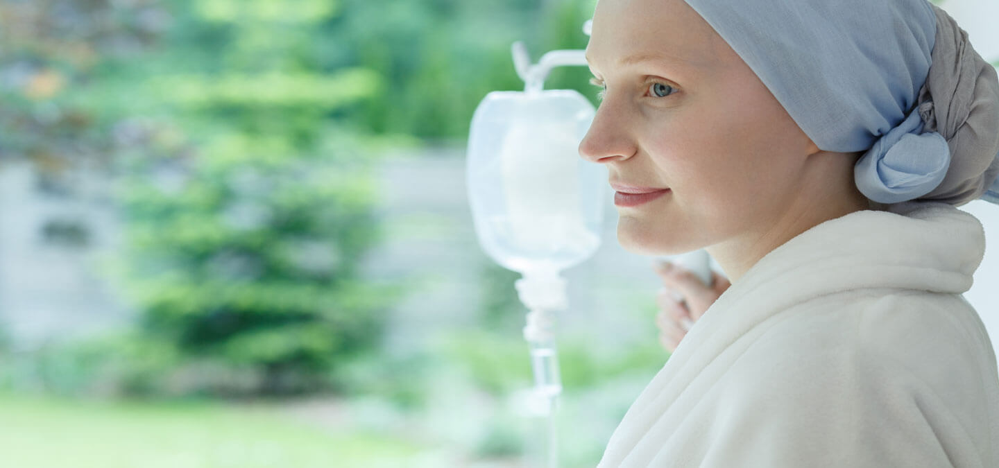 Woman undergoing chemotherapy looks out a window