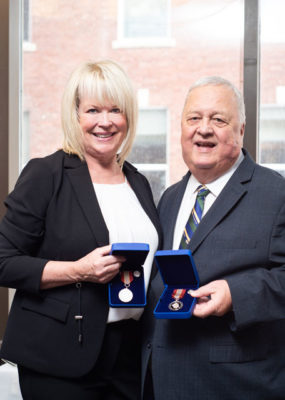 Gail and Phil with their medals.