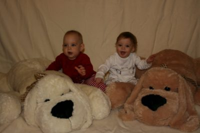 Rhys and Liam White with large toy doys on their first birthday