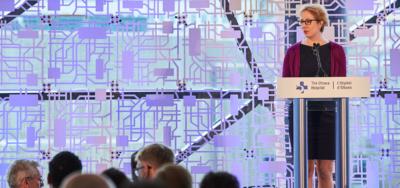 Annette Gibbons addressing the President's Breakfast for the Public Service in 2019.