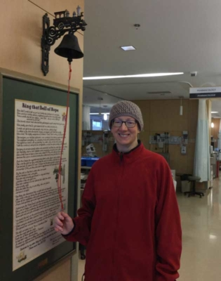 Annette ringing the bell of hope following her final cancer treatment.
