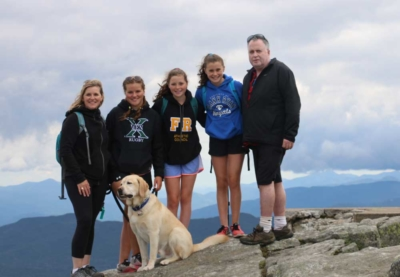 Ian McDonell with his wife Michelle (left), and their daughters Kendra, Macy, and Ainsley, hiking in the Adirondack Mountains in 2019.