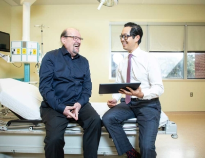 Oncologist Dr. Michael Ong of The Ottawa Hospital in a patient room.