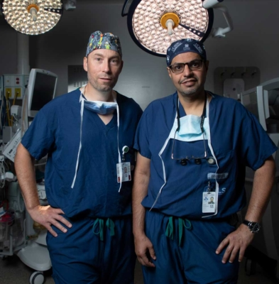 Hospital around the world are looking to The Ottawa Hospital tDr. Fahad AlKherayf and Dr. Shaun Kilty standing in an operating room at The Ottawa Hospital.