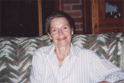 Patricia Whitehead in sitting on a couch in her home.
