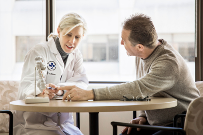 Doctor speaking with a patient in her office at a hospital