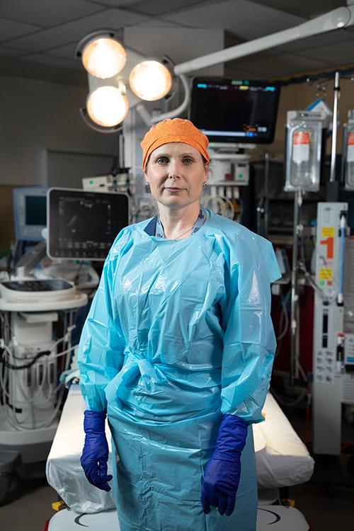 Doctor in scrubs standing in a hospital emergency room