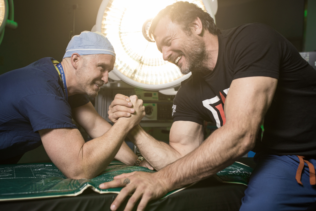 Devon and Dr. Pollock armwrestle