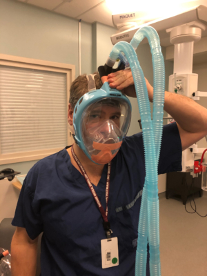 Dr. Neilipovitz trying on a prototype mask