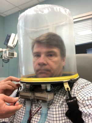 Dr. David Neilipovitz with an oxygen hood