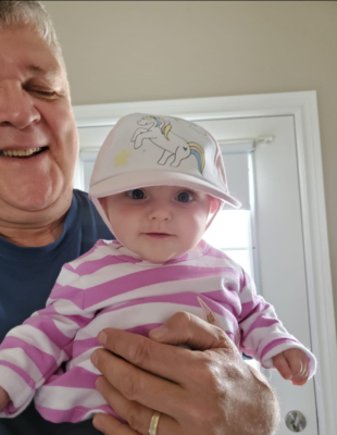 Mike Soloski with his grandchild