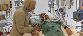 A.J. in ICU at the General Campus with his mother, Lynne.