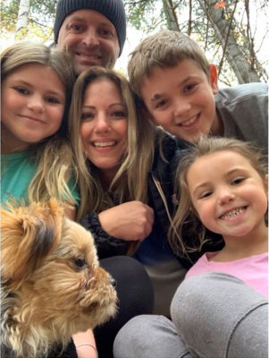 Gina Mertikas, centre, and her family