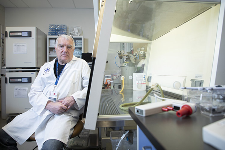 Dr. John Bell in lab
