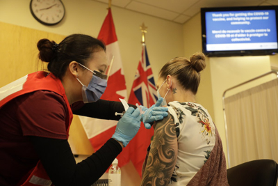 A nurse at The Ottawa Hospital administers the COVID vaccine to a healthcare worker.